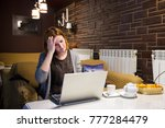 tired young woman working on... | Shutterstock . vector #777284479