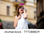 smiley girl pretending to be a... | Shutterstock . vector #777288829