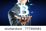 Small photo of businessman with a floating bitcoin symbol over his hand