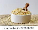 dehydrated onion flakes in a... | Shutterstock . vector #777308035