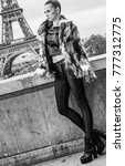 Small photo of Bold winter in Paris. modern fashion-monger in fur coat in Paris, France looking into the distance