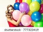 beautiful smiling girl hugging... | Shutterstock . vector #777323419
