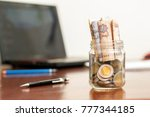 Coins And Banknotes In Jar ...