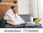 young man suffering from cold... | Shutterstock . vector #777362041