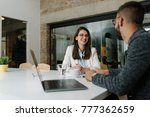 positive atmosphere at a job... | Shutterstock . vector #777362659