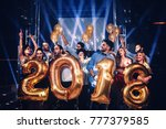 group of friends holding... | Shutterstock . vector #777379585