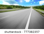 an empty countryside road with... | Shutterstock . vector #777382357