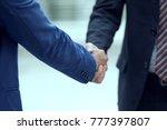 business or lawyer shake hands... | Shutterstock . vector #777397807