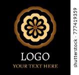 flower logo on black background   Shutterstock .eps vector #777419359