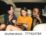diverse women in a backseat of... | Shutterstock . vector #777424789