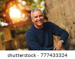 handsome middle age man outdoor ... | Shutterstock . vector #777433324