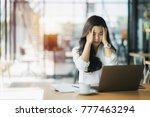 overworked businesswoman... | Shutterstock . vector #777463294