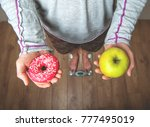 choosing between donut and... | Shutterstock . vector #777495019