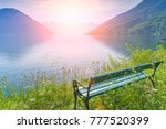 empty green wooden bench with a ... | Shutterstock . vector #777520399