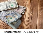 money isolated on a wooden... | Shutterstock . vector #777530179