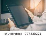 close up hands holding tablet... | Shutterstock . vector #777530221