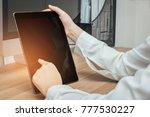close up hands touching screen... | Shutterstock . vector #777530227