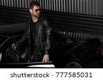 handsome brutal man in the car. ... | Shutterstock . vector #777585031