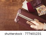 tourist's hand holding old ... | Shutterstock . vector #777601231