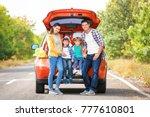happy family near car on the... | Shutterstock . vector #777610801