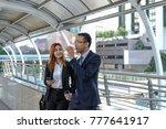 businessman and businesswoman... | Shutterstock . vector #777641917