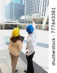 woman and man engineer are... | Shutterstock . vector #777643381