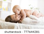 adorable baby kissing his... | Shutterstock . vector #777644281