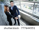 businessman and businesswoman... | Shutterstock . vector #777644551