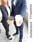 businessman and businesswoman... | Shutterstock . vector #777644554