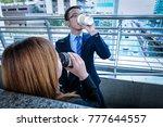 businessman and businesswoman... | Shutterstock . vector #777644557