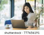 young business woman using on... | Shutterstock . vector #777656191