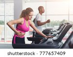 couple run on treadmills ... | Shutterstock . vector #777657409