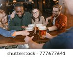 cropped image of barman giving... | Shutterstock . vector #777677641