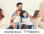 a man spends time with his sons.... | Shutterstock . vector #777686311