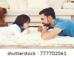 father has fun with his son. an ... | Shutterstock . vector #777702061