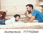 father has fun with his son. an ... | Shutterstock . vector #777702064