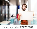 young cool man with a placard | Shutterstock . vector #777702181