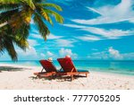 two beach chairs on tropical... | Shutterstock . vector #777705205