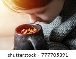 a young girl inhales the aroma... | Shutterstock . vector #777705391