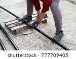 man is cutting black metal... | Shutterstock . vector #777709405