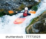 An Active Kayaker  Shooting A...
