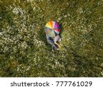 young couple lying down in the... | Shutterstock . vector #777761029