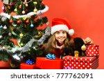 Miss Santa Gives Small Gift To...