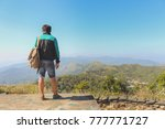 the man standing on ridge and... | Shutterstock . vector #777771727