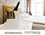 honeymoon concept. champagne...   Shutterstock . vector #777779215