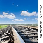 low view to railroad under deep blue sky - stock photo