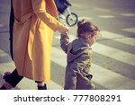 small girl holding mother's... | Shutterstock . vector #777808291
