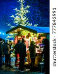BAD WIESSEE, GERMANY - DECEMBER 16: people and sales booth at the christmas market on December 16, 2017 in Bad Wiessee, Germany - stock photo