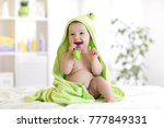 little baby boy in green towel... | Shutterstock . vector #777849331