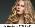 long curly hair blonde woman... | Shutterstock . vector #777856099